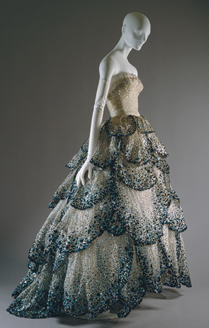 """Dior's """"Junon"""" dress, fall/winter 1949–50, pale-blue silk net embroidered with iridescent blue, green, and rust sequins. Collection at the Metropolitan Museum of Art."""