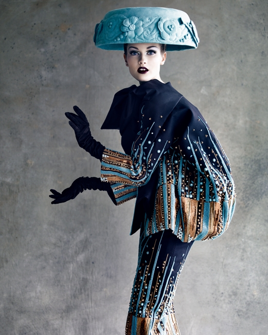 """Christian Dior Haute Couture 2008 - Shot by Patrick Demarchelier. One of John Galliano's more whimsical takes (he did several) on Dior's signature """"Bar"""" suit. Galliano took Dior's sculptured elegance into a realm of unparalleled theater and fantasy."""
