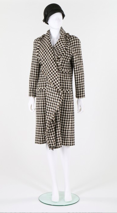 Lot 1 : A Chanel boutique black and white hound's tooth checked tweed coat, circa 2000. -
