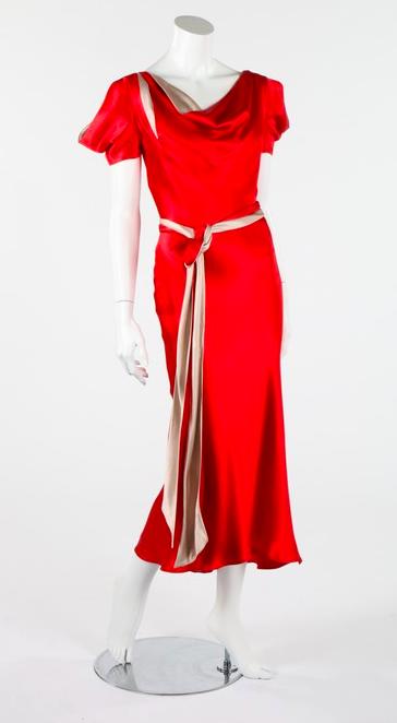 Lot 106 : An Alexander McQueen scarlet satin 30s inspired dress, 2007.