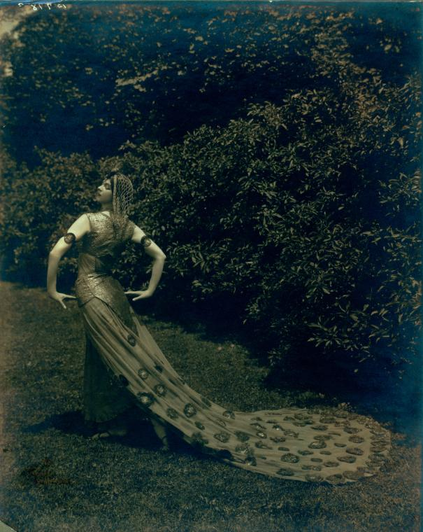 Photography by Jos Toloff of Ruth St. Denis posed for her role in Legend of the Peacock on the grounds of Ravinia Park, Chicago, Illinois, July 27th, 1914.